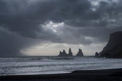Reynisfjara Black Sand Beach. And Reynisdrangar basalt sea stacks as seen near Vik, Iceland Royalty Free Stock Photos