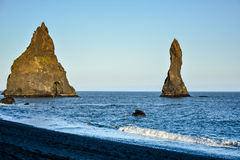 Reynisfjara black sand beach and rocks near  Vik town, Iceland Stock Images
