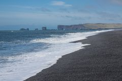Reynisfjara rock formations. Wide view of Reynisfjara rock formations and stone beach, Halsanefhellir, Iceland Royalty Free Stock Photography