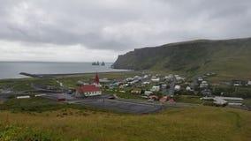 Vik. Reyniskirkja, Vik and sea stacks royalty free stock photography