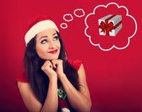 Rezando a mulher no Natal de Papai Noel traje a vista acima e o miliampère Fotos de Stock