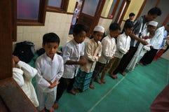 Rezos en la mezquita Foto de archivo libre de regalías