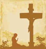 Rezos por la cruz, fondo del grunge Foto de archivo libre de regalías