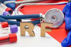 RF medical abbreviation meaning rheumatoid factor in blood in laboratory diagnostics on red background. Chemical name of RF is sur. Rounded by medical laboratory stock photos