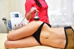 Rf skin tightening, belly. Hardware cosmetology. Body care. Non surgical body sculpting. Ultrasound cavitation body contouring tre. Atment, anti-cellulite and stock photography