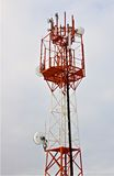 RF-Tower. On the cloudy overcast sky background Royalty Free Stock Photos