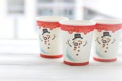 RFestive静物画:与雪人的图片的三块玻璃 库存照片