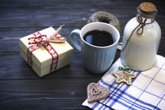RFestive still life with a bottle, a cup, biscuits, a box Stock Photos