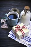 RFestive still life with a bottle, a cup , biscuits, a box Royalty Free Stock Image