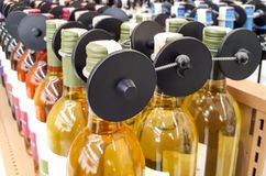 RFID hard tag on alcoholic drinks bottle. RFID hard tag  - Shoplifting and anti-theft system - Electronic Article Surveillance system used with high-value goods Stock Images