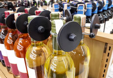 RFID hard tag. Shoplifting and anti-theft system - Electronic Article Surveillance system used with high-value goods - Alcoholic drinks bottle Royalty Free Stock Image