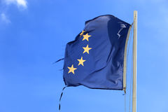 480767RFM. Ripped EU flag fluttering in the wind Stock Photos