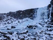 Rfoss καταρράκτης ã-Xarà ¡ το χειμώνα που καλύπτεται στο χιόνι πάγου ANS στοκ φωτογραφίες με δικαίωμα ελεύθερης χρήσης
