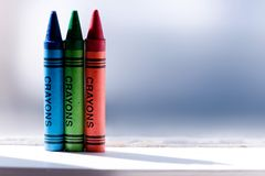 RGB. Red, green, and blue crayon on ledge stock image
