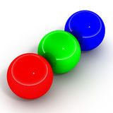 Rgb balls. Shiny balls in red, blue and green showing primary RGB profile colors on white background Stock Photo