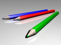 RGB Colored Pencils. Three wooden colored pencils in RGB - red, green and blue Royalty Free Stock Photo
