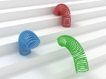 Rgb colorful springs on the white steps Royalty Free Stock Image