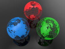 RGB earth globes concept. 3D rendered illustration of the RGB earth globes concepts. The composition is  on a black metallic background Royalty Free Stock Photography