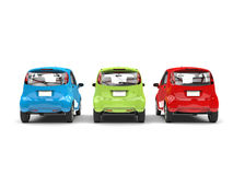 RGB economic compact electric cars - back view Stock Photography