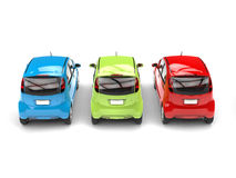 RGB economic compact electric cars - rear view Royalty Free Stock Photos