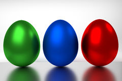 RGB eggs. Red green and blue eggs in a row Royalty Free Stock Images