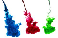 RGB ink splash in water. RGB red green blue Ink splash in water isolated on white background royalty free stock photography