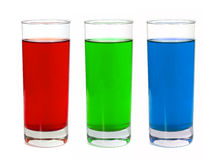 RGB juice glasses. Red green blue liquid in glasses isolated on white Stock Photography