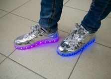 RGB LED backlight integrated into the sole of the sneaker royalty free stock images