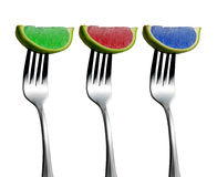 RGB Limes. Colored limes on forks royalty free stock image