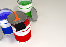 Red, Green & Blue Paint Buckets. Red, green and blue color paint tin cans with a brush on top view isolated on white to grey background Stock Photos