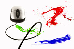 Paint strokes flying around computer mouse Royalty Free Stock Photos