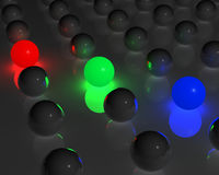 RGB spheres. RGB glowing spheres among many gray spheres Stock Photography