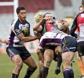 RGL: Rugby-Liga-Harlekine gegen Melbourne-Sturm stockbild