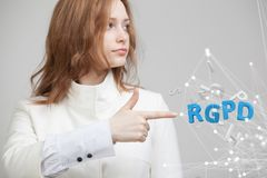 RGPD, Spanish, French and Italian version version of GDPR: Reglamento General de Proteccion de datos. General Data. Protection Regulation. Young woman working stock photo