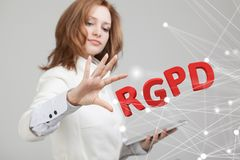 RGPD, Spanish, French and Italian version version of GDPR: Reglamento General de Proteccion de datos. General Data. Protection Regulation. Young woman working royalty free stock photos