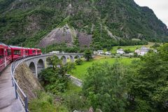 Rhaetian Railway crossing a bridge in the Surselva valley stock image