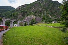 Rhaetian Railway crossing a bridge in the Surselva valley stock photos