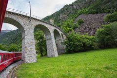 Rhaetian Railway crossing a bridge in the Surselva valley stock image