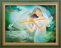 Rhapsody of the sea. Portrait of beautiful girl playing the flute in the fantasy environment. Oil painting on canvas. Royalty Free Stock Images