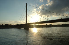 Rhein in sunset. Bridge over Rhein in evening sunrays royalty free stock photo