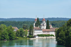 Rheinau Abbey across Rhine, Switzerland Royalty Free Stock Image