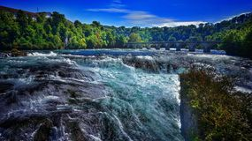 Rheinfall at noon. Rheinfall in der Schweiz Stock Photo