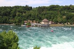 Rheinfall in Switzerland near Schaffhausen. Rheinfall is the bigge. Switzerland. Rhinfall is the biggest waterfall in Europe. Boat attraction Stock Photography