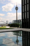 Rheinturm  in Duesseldorf -. Telecommunications tower - reflection in the water fountain Stock Images