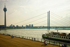 Rheinturm Tower and Rhine embankment promenade in Dusseldorf Royalty Free Stock Photo