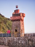 Rehenish Tower Lunmouth Devon UK. The Rhenish Tower on the quay at Lynmouth, Devon, UK. This tower was built in the 19th Century, modelled on watchtowers on the royalty free stock photography