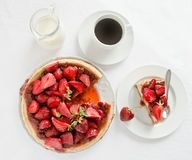 Rheum cheesecake with strawberries and koffee. On white tablecloth Stock Photos