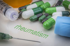 Rheumatism, medicines and syringes as concept Stock Photos