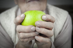 Rheumatoid arthritis hands and fruits Royalty Free Stock Photos