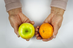 Rheumatoid arthritis hands and fruits Royalty Free Stock Photography